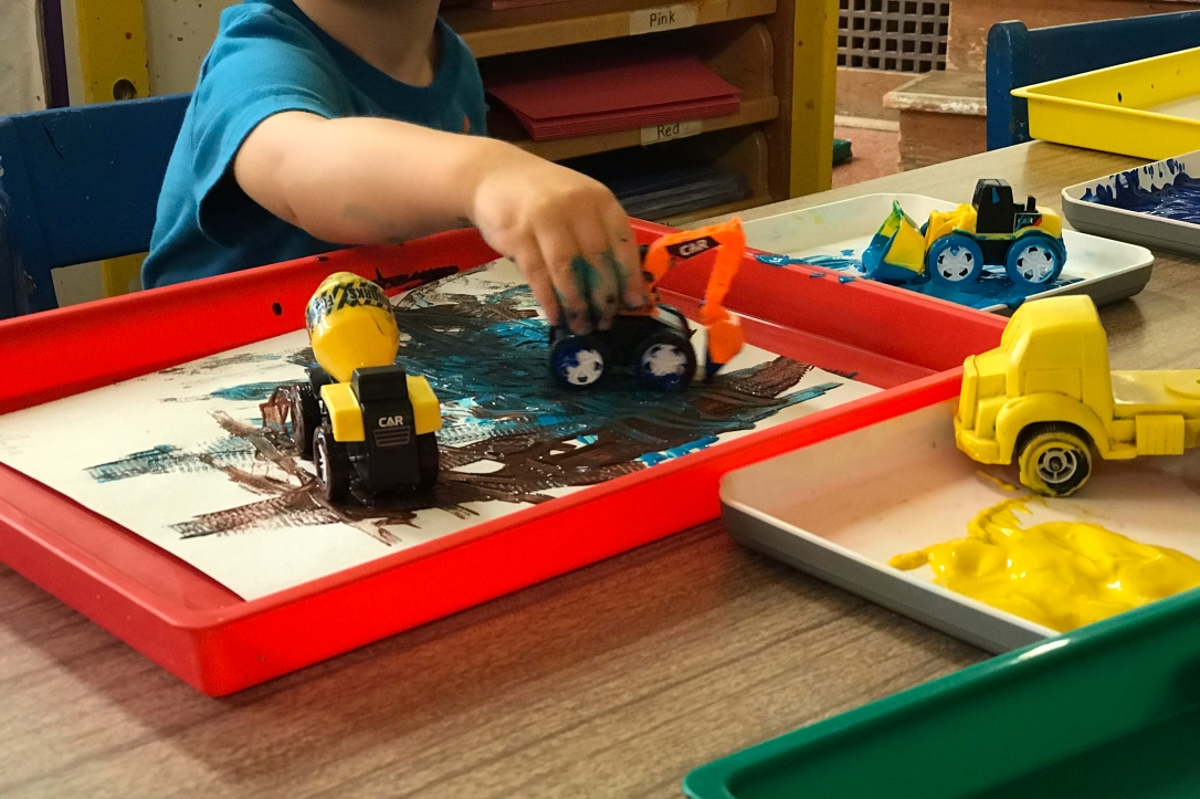 University-Ravenna Cooperative Preschool : Painting with toy trucks - we love messy art!