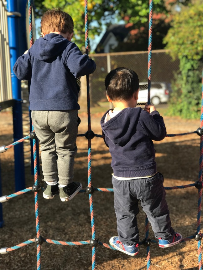 University-Ravenna Cooperative Preschool : Climbing on the Bryant Elementary School playground during outdoor recess in the Pre-3s Class