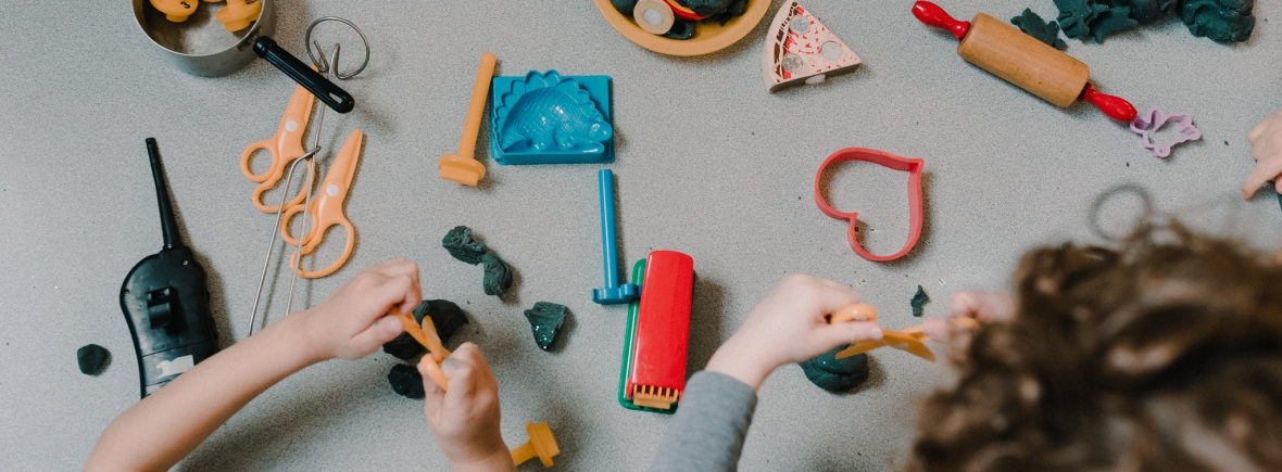 University-Ravenna Cooperative Preschool : Using scissors, stamps, cookie cutters, and rolling pins with play dough