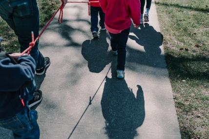 University-Ravenna Cooperative Preschool : Walking outside using a child safety walking rope