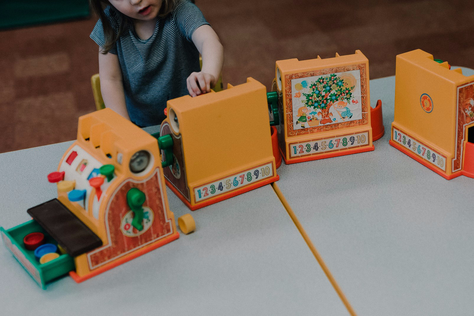 University-Ravenna Cooperative Preschool : Playing with toy cash registers in the Pre-3s Class
