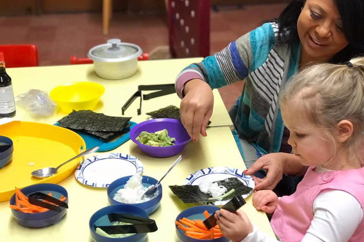 University-Ravenna Cooperative Preschool : Making sushi with Teacher Christi in the Pre-3s Class
