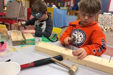 University-Ravenna Cooperative Preschool : Hammering nails into wood - woodworking - teaching practical skills